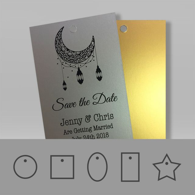 Save the date wedding swing tags in a metallic gold and silver material with a luxury smooth finish.